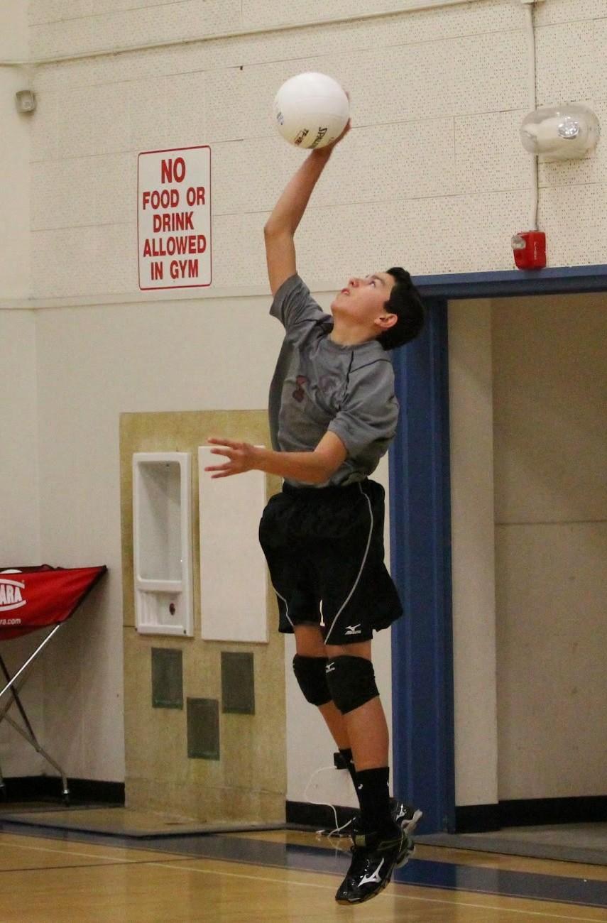 Freshman Chad Talaugon winding back for a serve. Credit: Sarah Kagan/The Foothill Dragon Press