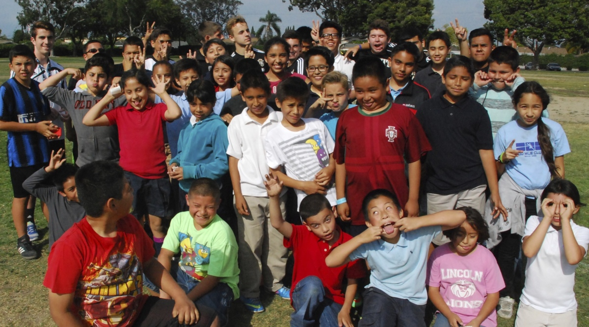 After a long day of fun activites, the kids and volunteers pose for a group shot.