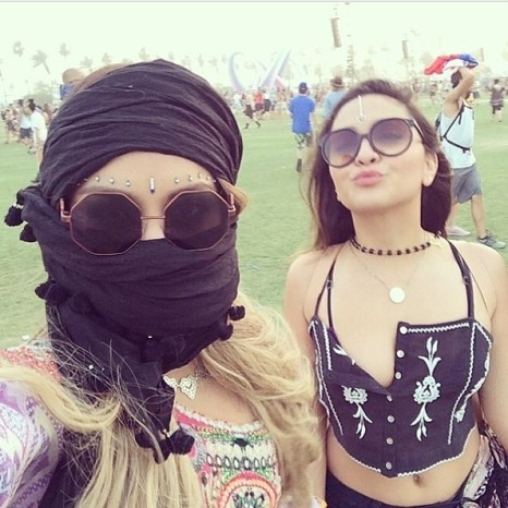 Coachella attendees wearing traditional Desi jewelry, bindhis, and hijabs