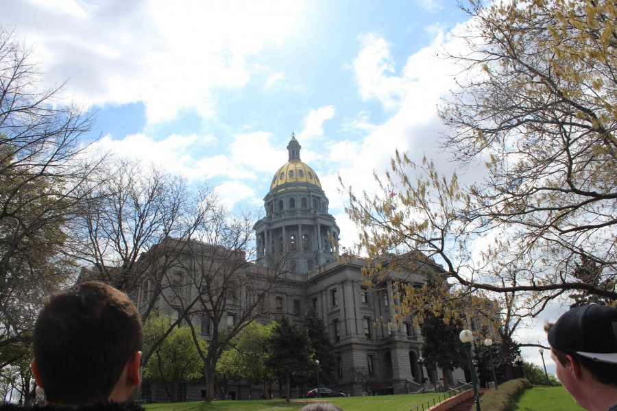 Junior Joseph Mousaed and Senior Brandon Gilden admire the golden dome on Denver's Capitol Building as it shines in the morning light. The dome is one of only a few gold leafed domes in the US. Students went to the Capitol Building to stand on the mile-high marker. (Veronica Godoy)