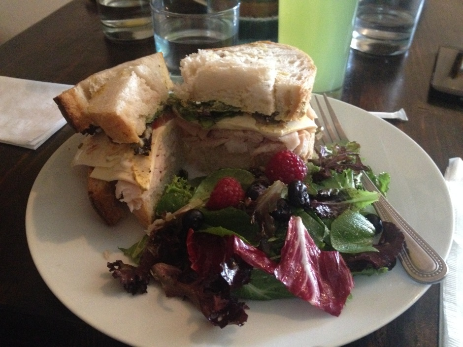 A nicely seasoned turkey sandwich with mixed greens - yummy!