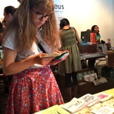 Girl reading mini zine