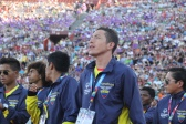 A Team Ecuador athlete admires the unwavering support of the Coliseum fans during the Special Olympics World Games Opening Ceremony on Saturday.