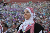 A Team Jordan participant gazes out at the sea of people before her during the Special Olympics World Games Opening Ceremony on Saturday.