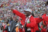 A Special Olympics coach fist pumps the sky with his passion for the games during the Special Olympics World Games Opening Ceremony on Saturday.