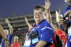 An athlete from Team USA flashes his joy and excitement to the fans during the Special Olympics World Games Opening Ceremony on Saturday.