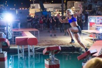 "At the start of the ""American Ninja Warrior"" national finals course, Graff bounds across the quintuple steps."