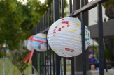 Lanterns decorate the fence