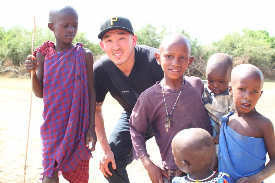 Arthur Han poses with some of the local Maasai children in Tanzania. Courtesy of Han-Schneider.