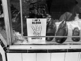 Aug. 1965: During the Watts Riots, sign sits in window of store owned by African American. In some cases the signs, were disregarded and the business damaged by rioters.