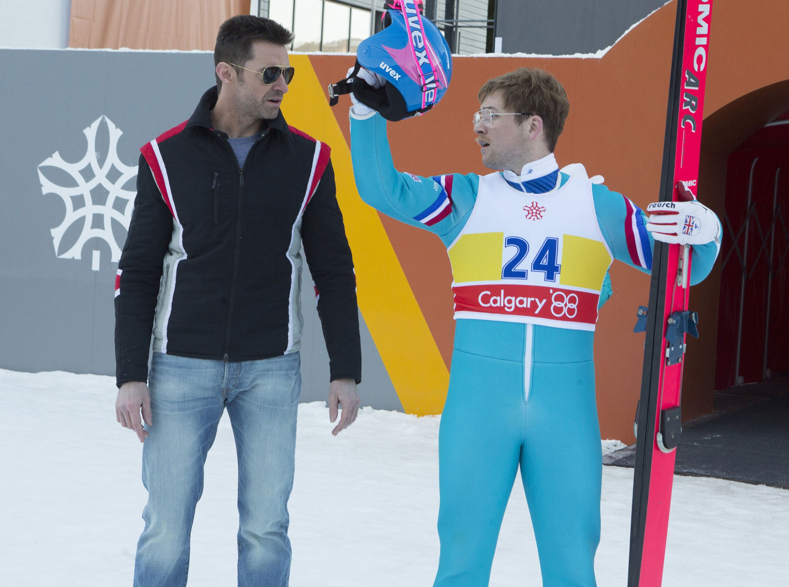 Taron Egerton, right, and Hugh Jackman star in EDDIE THE EAGLE. Photo Credit: Larry Horricks. Courtesy of Twentieth Century Fox.