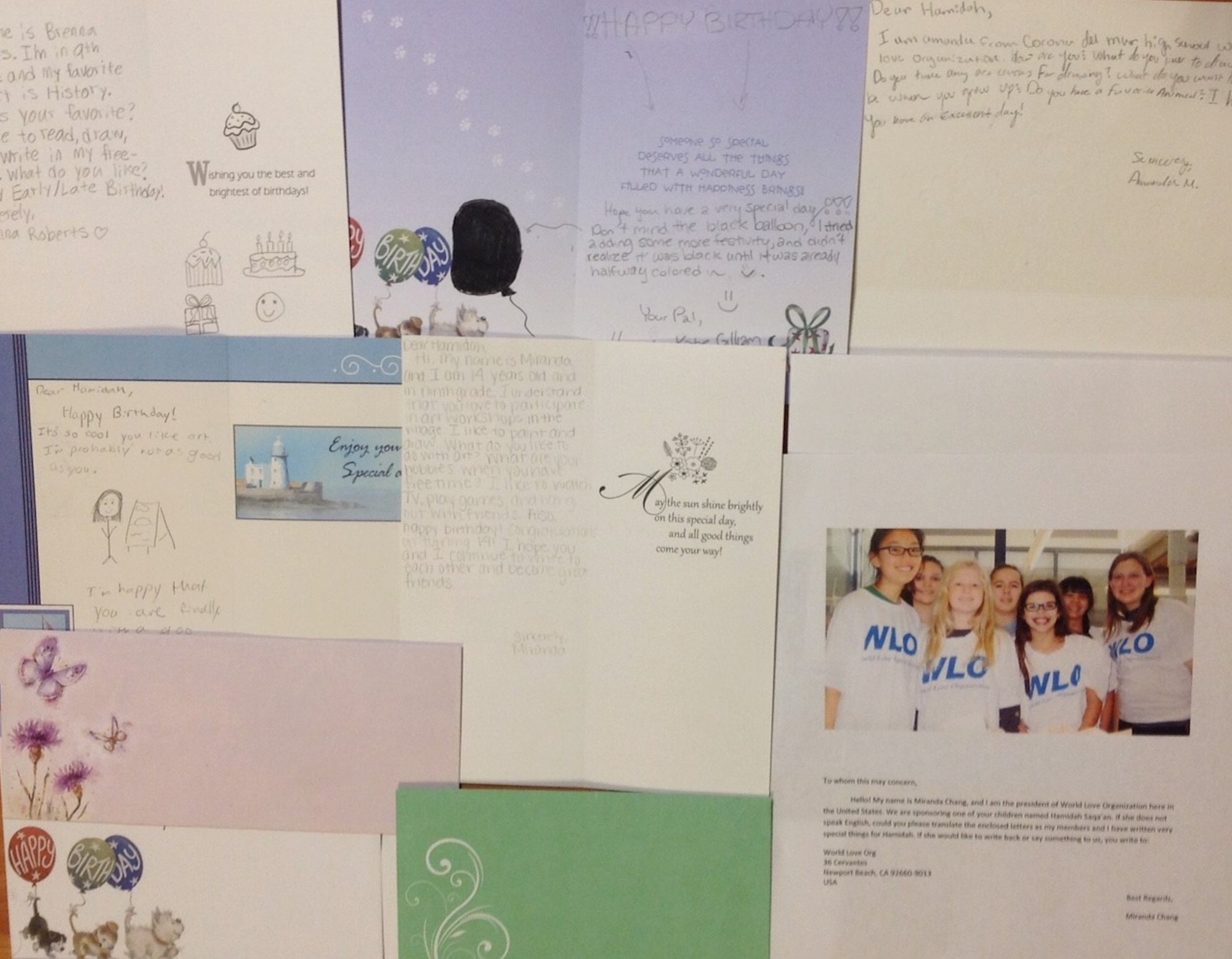 Birthday Letters to the Syrian girl along with a photo of WLO members