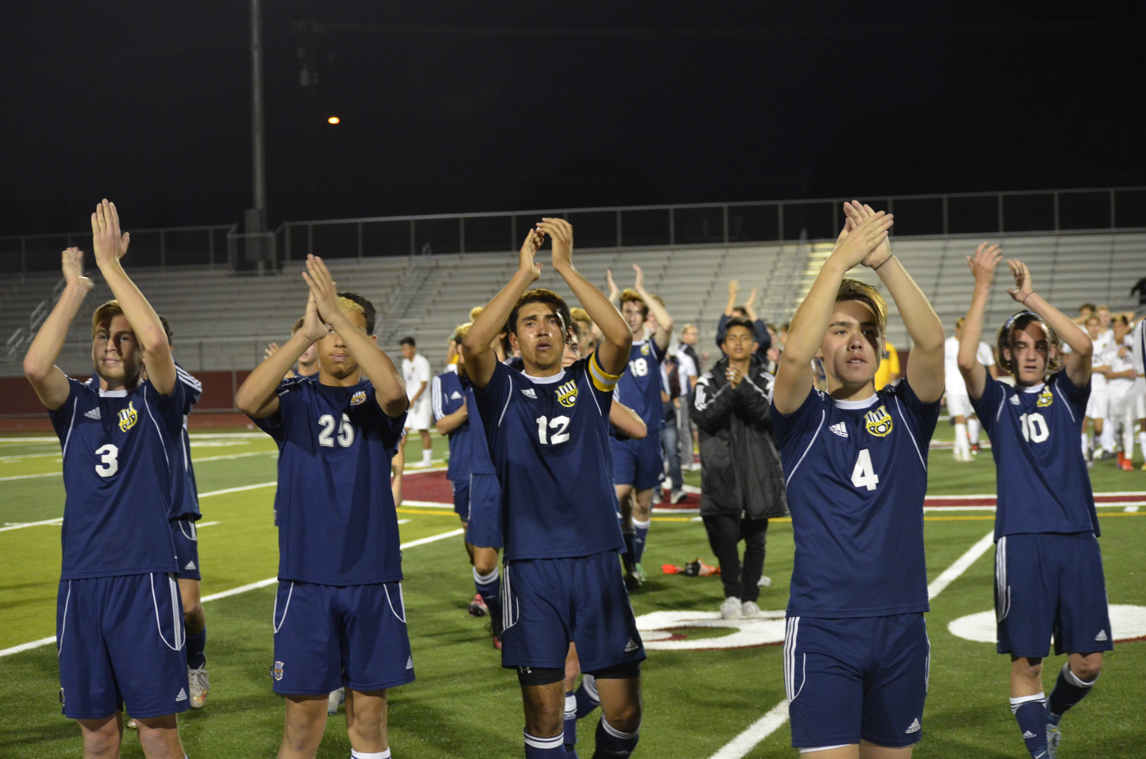 Agoura players applaud the Ontario audience after the game.