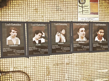 """Posters of the student cast, including the """"Barricade Boys"""" have been posted around GHCHS to promote the show."""