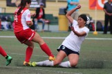 Sophomore Diana Garcia attempts to slide tackle her opponent.