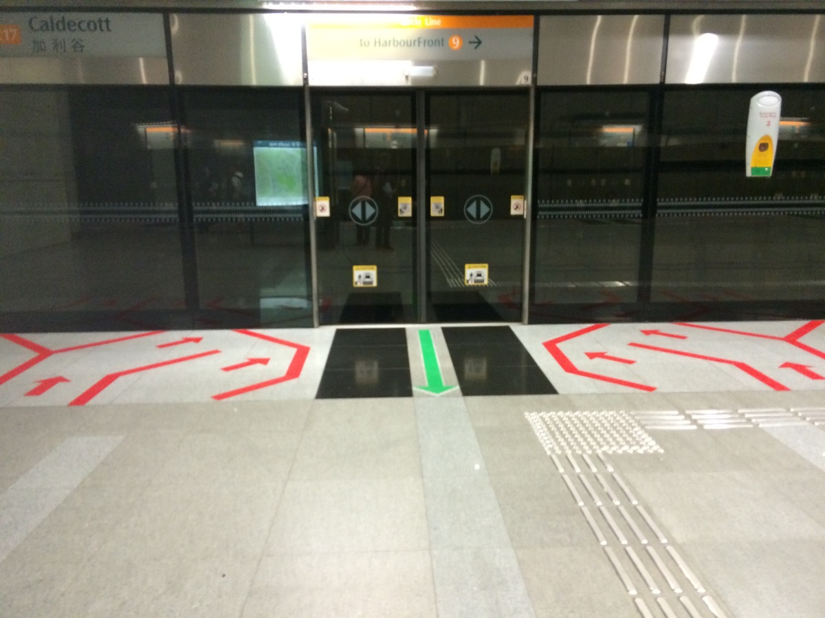The markings on the floor tell passengers where to board and get off the train. The rails on the floor guide the blind to train doors, and the glass keeps people from falling off the platform.