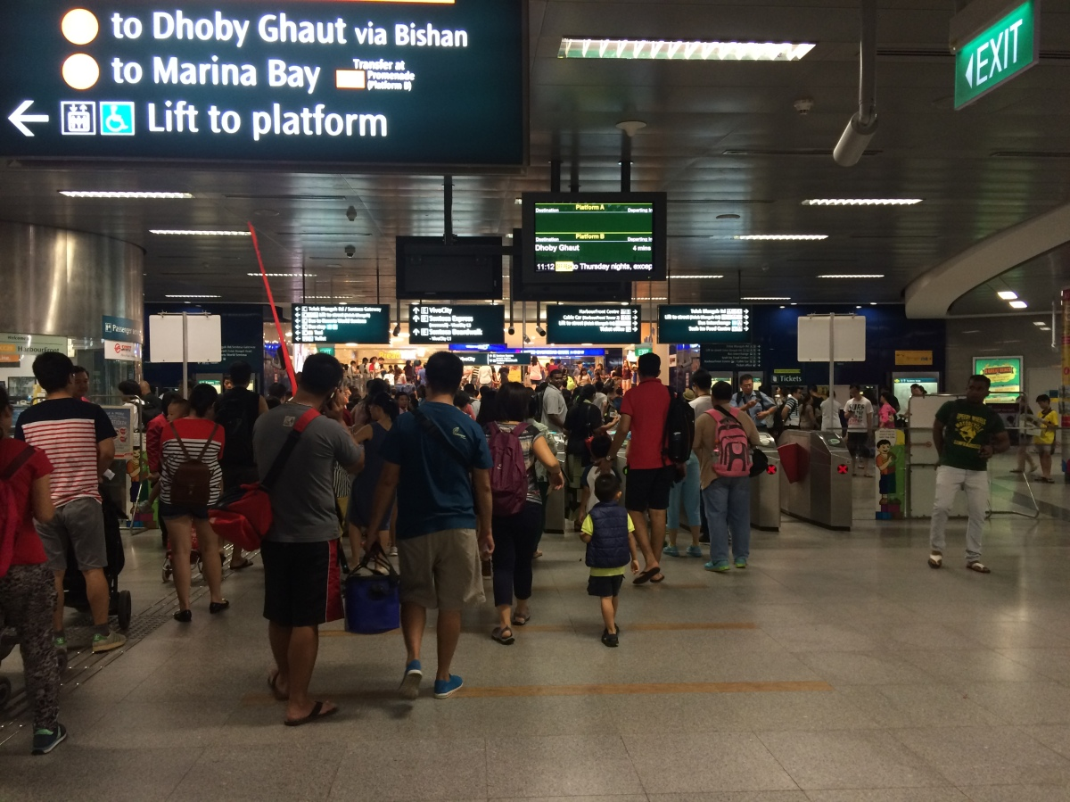 People crowd the exit of an MRT station. Most are heading to the VivoCity mall, whose entrance can be seen.