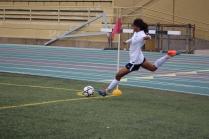 Senior Eduvina Godinez executes a corner kick.
