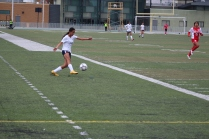 Junior Soledad Corrales centers the ball as she seeks a teammate near the goal to head it in and score.