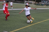 Junior Soledad Corrales attempts to keep the ball in during the final minutes of the game.