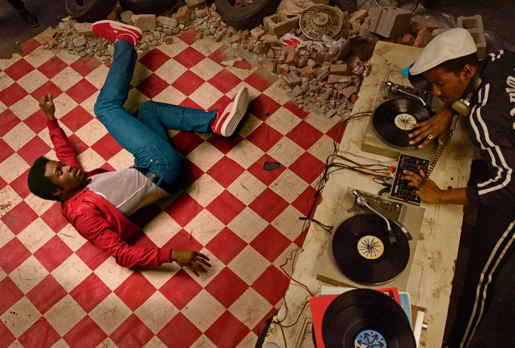 Shameik Moore (break dancing) and Mamoudou Athie (deejaying) channel the late-'70s Bronx in costumes from the production. Vogue
