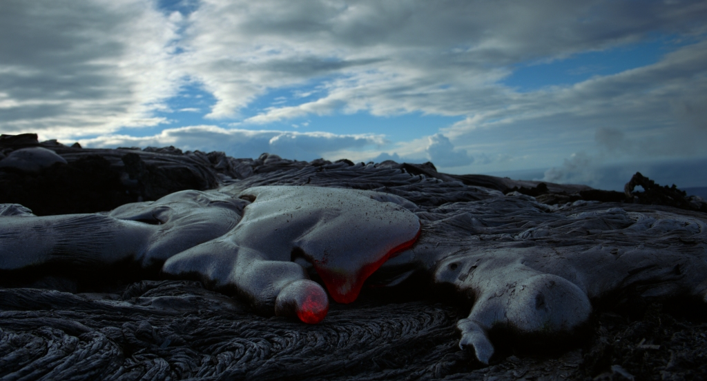 Lava cools and hardens to form rock on the early Earth as depicted in the new IMAX® film Voyage of Time: The IMAX Experience®.