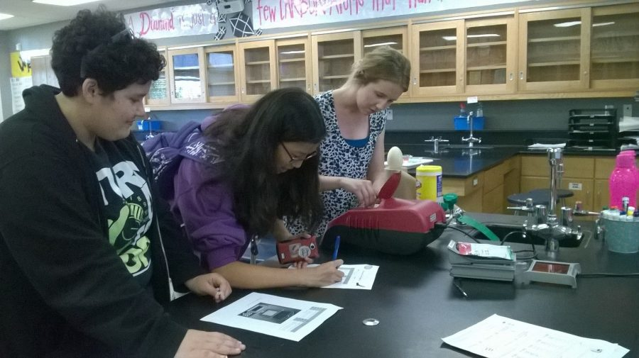 Stephanie Wang and Amanda Figueroa work with Ms. Malinchak with the condor DNA. Picture taken by Priscila Manzo.