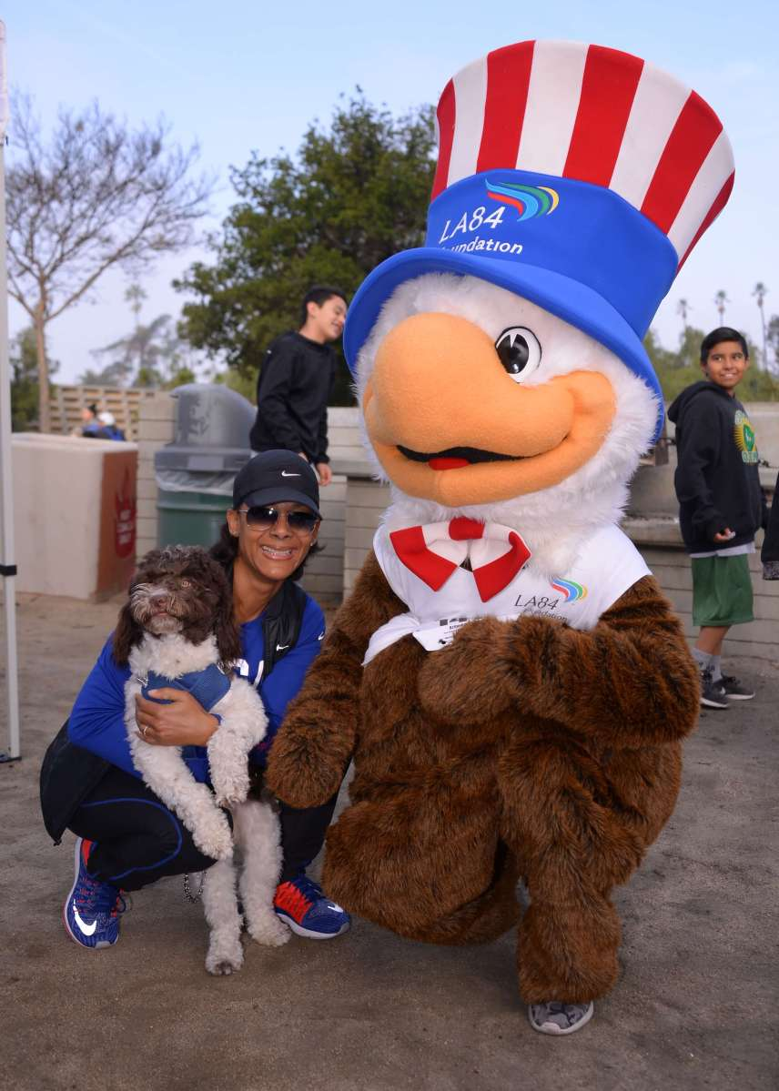 LA84 President and CEO Renata Simril with Sam the Eagle. Courtesy: Jon Soohoo/LA84 Foundation
