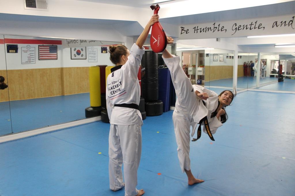 Second degree black belt Danielle Tolsma practices kicking techniques.