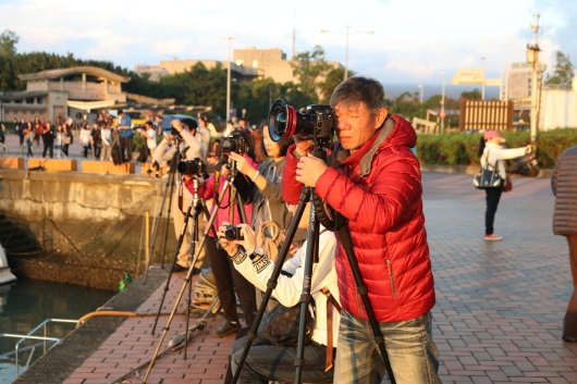 Photographers capturing the sunset
