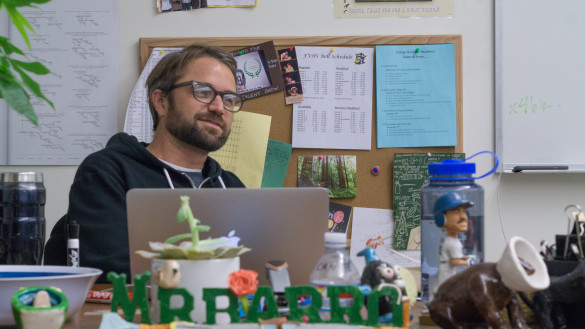 Mr. Barro kicking back and relaxing in his pleasant classroom. Photo by Jake Winkle