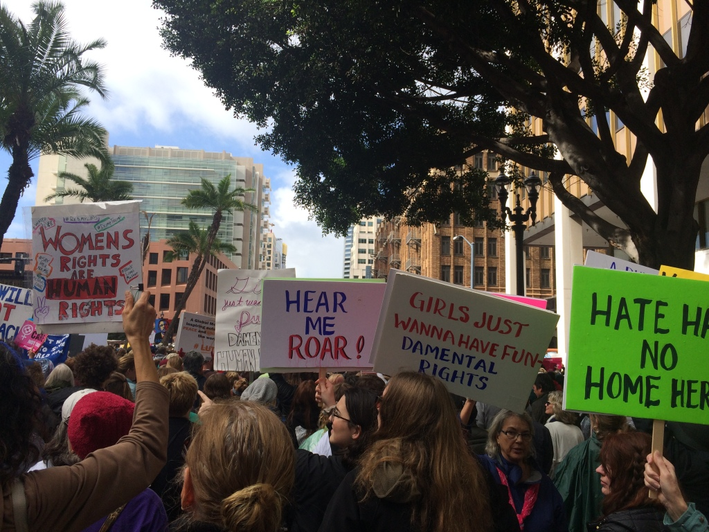 Advocates for women's rights marched in downtown San Diego carrying posters and chanting.
