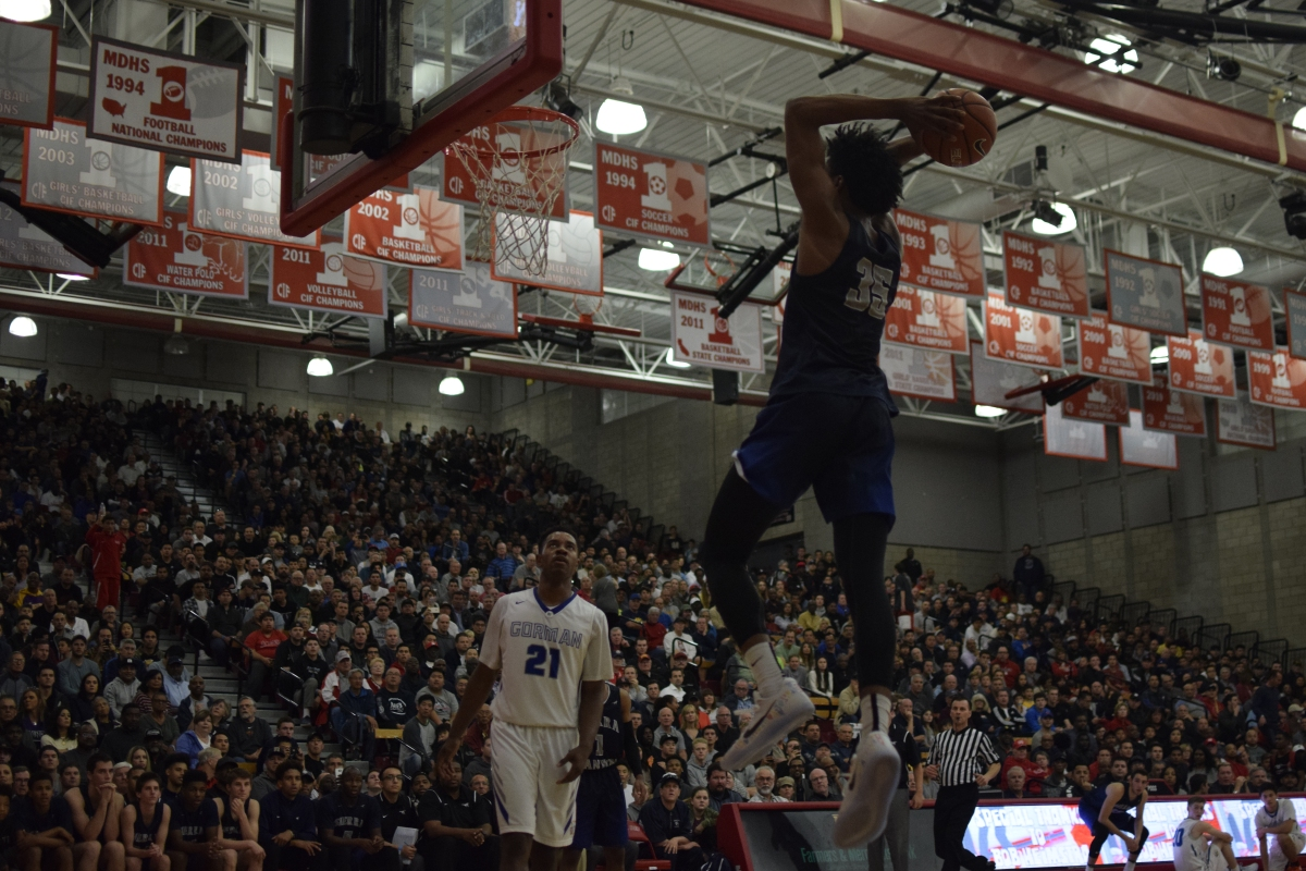 M. Bagley III dunks on Bishop Gorman defenders, while putting up 43 of the team's 47 points on the scoreboard. Caleb Ragan/LA Times HS Insider