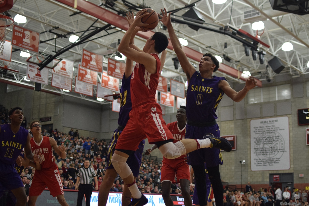 Michael Wang goes for a layup. Caleb Ragan/LA Times HS Insider