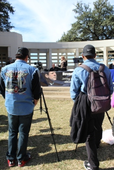 Videographers including senior Kevin Garcia (right) took footage of the annual event held by conspiracy theorists, who believe there were two shooters, in honor of JFK assassination at Dealey Plaza. Photo by Rachel Bullock