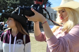 The Pearl Net News (PNN) team takes footage for their video about the convention. Seniors Nikita Opel and Sandra Ortega work on B-roll of Dealey Plaza and the site of JFK's assassination. Photo by Rachel Bullock