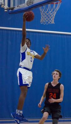 26197395738 3025151fe1 o 2 343x600 Freshman Jeremiah Davis makes a slam dunk in varsity basketball